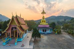 Aerial photography the golden buddha statue in Chiang Rai. Aerial photography the golden buddha statue at wat Sirattanan Mongkol near Mae Kajan Hot Spring Wiang royalty free stock photography