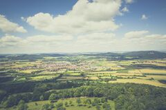 Aerial Photography of Green Fields Under Blue Sky and White Clouds during Daytime Stock Images