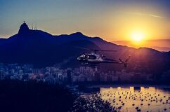Aerial Photography of Helicopter during Twilight Stock Images