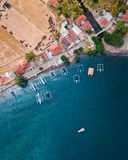 Aerial Photography of Houses Near Body of Water With Boat stock photography