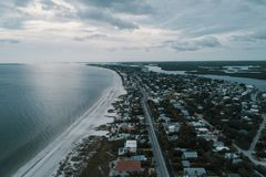 Aerial Photography of Houses Near Ocean royalty free stock photography