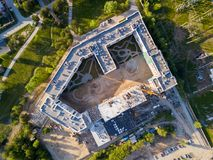 Aerial photography of a modern house. Aerial photography of a modern  high-rise buildings, a big road, parkink and parks on a warm summer day. Helicopter drone Stock Image