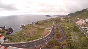 Aerial photography of motorway near and sea coast of Tenerife Canary. Aerial photography of motorway near the sea coast of Tenerife Canary Islands Spain stock footage