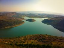 Aerial Photography of Mountain Near Body of Water during Daytime Stock Images