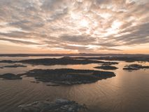 Aerial Photography of Mountains Near Body of Water Stock Photo