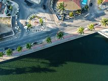 Aerial Photography of Paved Road Near Body of Water royalty free stock photo