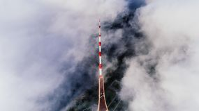 Aerial Photography of Red and White Striped Tower Near Clouds Royalty Free Stock Photos