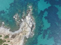 Aerial photography of the Sardinia coast during a summer sunset. Small waves on the rocks taken with a drone stock photography