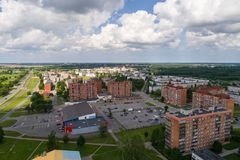 Aerial photography. Small city landscape, amazing clouds. Summer city landscape. Aerial photography Royalty Free Stock Photo
