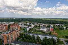Aerial photography. Small city landscape, amazing clouds. Summer city landscape. Aerial photography Stock Images