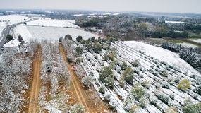 Aerial photography of the snowy scenery of ten thousand mu tea garden in Xuancheng, Anhui Province, China. On December 9, 2018, in Xuancheng, Anhui Province royalty free stock image