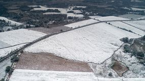 Aerial photography of the snowy scenery of ten thousand mu tea garden in Xuancheng, Anhui Province, China. On December 9, 2018, in Xuancheng, Anhui Province stock photography