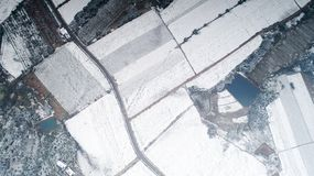 Aerial photography of the snowy scenery of ten thousand mu tea garden in Xuancheng, Anhui Province, China. On December 9, 2018, in Xuancheng, Anhui Province stock photos