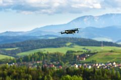 Aerial photography and videography. Drone flying over mountain f. Drone with camera flying over mountain fields. Aerial photography and videography. Drone quad stock photo