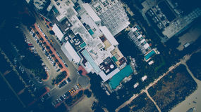 Aerial Photography of White and Green Building Near Road Surrounded by Green Trees Royalty Free Stock Image