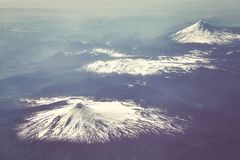 Aerial picture of the Andes mountain range, Chile. Retro stylized aerial picture of the Andes mountain range, Chile Royalty Free Stock Photos