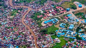 Aerial picture of dense population neighborhood split by the river. Social and environmental issue background stock photos