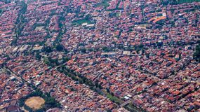 Aerial picture of dense population neighborhood in West Java, Indonesia royalty free stock image