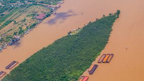 Aerial picture of empty barges waiting to be loaded near the coal stockpile. royalty free stock photos