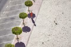 Aerial picture of an empty parking lot by a beach.  Royalty Free Stock Photos