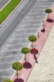 Aerial picture of an empty parking lot. Aerial picture of an empty parking lot with trees and pavement Stock Photography