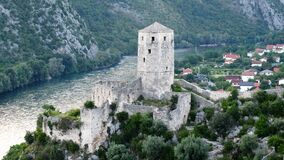 Aerial Picture of Gray Stone Tower Beside River and Town royalty free stock images