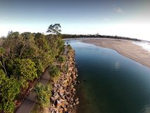 Aerial picture image of Noosa Spit by break water. Noosa spit alongside noosa river along rock wall and bike track and walking trail for holiday makers Royalty Free Stock Photos