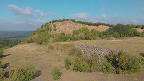 Aerial picture from a old basalt mine in Hungary, village Zalahalap.  stock video footage