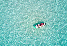 Aerial picture of a woman on a surfboard in turquoise waters Stock Photos