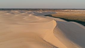 Aerial picture of young people standing on the peak of a sand dune in beautiful desert environment. Santa Cruz, Bolivia - SEPT 5 2018: aerial picture of young royalty free stock photos