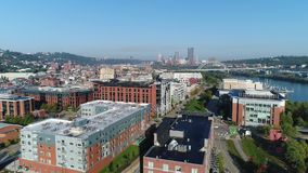 Aerial Pittsburgh South Side. 9284 A slowly rising forward aerial establishing shot over Pittsburgh`s South Side District on an early summer morning stock footage