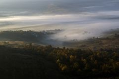 Wonderful view with drone flying above fog royalty free stock images