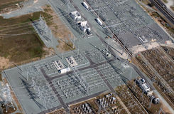 Aerial Power Infrastructure. Aerial image of electrical substation featuring wires, transformers and large scale power energy towers stock photos