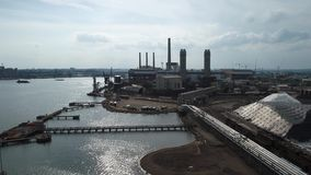 Aerial power plant 4k. Industrial power plant on the river 4k stock video footage