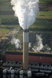 Aerial of power station chimney. Aerial of a smoking chimney of a power station Stock Images