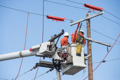 Aerial powerline workers Stock Photos