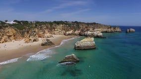 Aerial from Praia Tres Irmaos in Alvor Portugal stock video