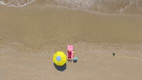 AERIAL: Pretty young woman sunbathing on beach. Antalya stock video footage