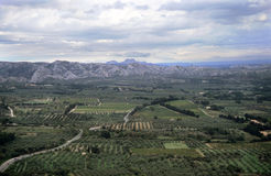 Aerial Provence. Narrow roads twist through olive groves and vineyards toward Les Baux-de-Provence and the Alpilles mountain range Stock Photography