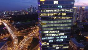 Modern buildings capital of Russia. Sunset evening night illumination. Light windows. Begovaya metro. Road traffic from above. Aerial quadcopter flight. Begovaya stock footage