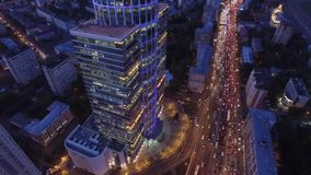 Modern buildings capital of Russia. Sunset evening night illumination. Light windows. Begovaya metro. Road traffic from above. Aerial quadcopter flight. Begovaya stock video