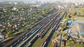 Aerial of railroad hub or railway terminal static bird-eye footage. Aerial of railroad hub or railway terminal static bird-eye footage and train passing by fast stock video