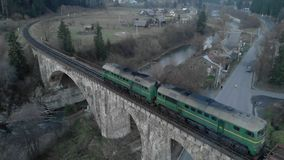 Aerial railway bridge across the river, the train passes over the bridge stock footage