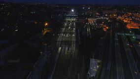 Aerial railway wagons at the railroad yard. View from the sky on railroad at night. The railway station aerial. 4K stock footage