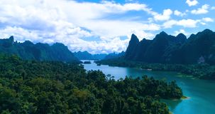 Aerial: A rainforest and mountains on a beautiful lake. Cheow Lan lake. Khao Sok. Thailand stock footage