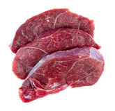 Aerial of raw red meat steaks isolated against a white backgroun Stock Photos