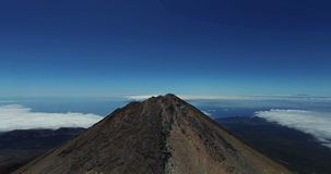 AERIAL. Reaching the top of Mount Teide vulcano. National Park, Tenerife, Canary Islands, Spain stock footage