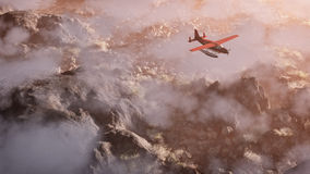 Aerial of red airplane flying over grey rock mountain landscape. With clouds. Panoramic shot Royalty Free Stock Photography