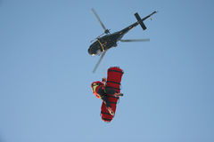 Aerial Rescue Platform. A rescue worker flies undr a helicopter with a patient in a rescue stretcher Stock Photography
