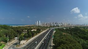 Aerial revealing shot of road leading to city, establishing shot stock video